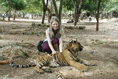 Tourist girl and Tiger Stock Photography