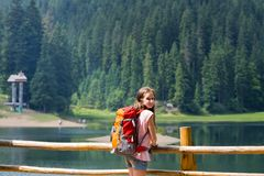 The tourist girl. Tourist girl and mountain views at the  lake Synevyr. Carpathians,  Ukraine. beautiful landscape royalty free stock photo