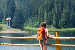 The tourist girl. Tourist girl and mountain views at the  lake Synevyr. Carpathians,  Ukraine. beautiful landscape stock photos
