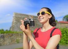 Tourist girl using camera. Stock Photo