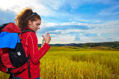 Tourist girl view of green wheat hills. Stock Images
