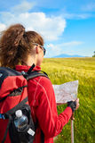 Tourist girl view of green wheat hills. Royalty Free Stock Image