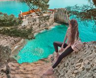 Tourist girl visiting Montenegro. Traveller sightseeing Old Venetian Castello Fortress is attraction symbol of the Montenegrin to. Wn of Petrovac in Budva stock image