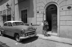 A tourist girl waiting for Cuban driver in Havana stock images