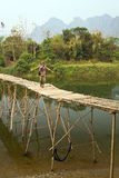 Tourist girl walking on bamboo bridge, vang vieng, laos Stock Image