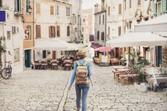 Tourist girl walking in the city during vacation. Cheerful woman traveling abroad in summer. Travel and active lifestyle concept. Tourist girl walking in the royalty free stock photo