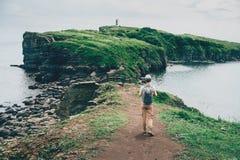 Tourist girl walking on island in summer Stock Photo