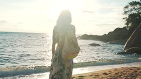 Tourist girl walking by the ocean stock footage