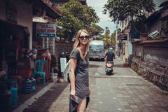 Tourist girl walking trade streets of Ubud Royalty Free Stock Photography