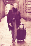 Tourist girl walking with the travel bag Royalty Free Stock Photos