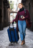 Tourist girl walking with the travel bag Royalty Free Stock Photography