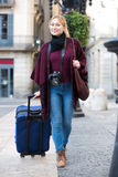 Tourist girl walking with the travel bag Royalty Free Stock Image