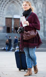 Tourist girl walking with the travel bag Stock Photography