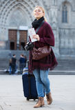 Tourist girl walking with the travel bag Stock Photos