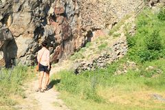 Girl walking on castle Girls Stone. Tourist girl - young woman on path by wall on castle Girls Stone, Czech Republic Stock Photo