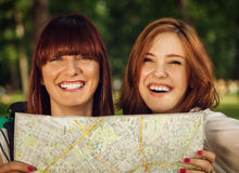 Tourist Girls With Map Stock Images