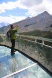 Tourist at the Glacier Skywalk in Jasper National Park Stock Images