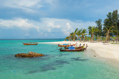 Tourist go to Koh Lipe sunrise beach by longtail boat Stock Image