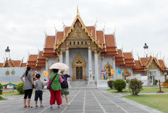Tourist go to Wat Benchamabophi. Bangkok,THAILAND - AUG 14: 2016. Tourist go to Wat Benchamabophit Dusitvanaram (The Marble Temple) is a Buddhist temple in the stock photography