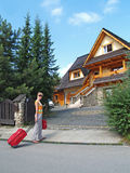 The tourist goes to a country house to Zakopane, Poland Royalty Free Stock Photo