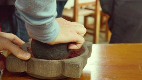 Tourist Grinding With A Mortar Roasted Cocoa Beans Ecuador. Detail Shot stock footage
