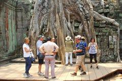 Tourist group ancient Ta prohm temple Angkor, Cambodia Stock Photos
