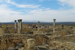Tourist group at ancient Volubilis town ruins Royalty Free Stock Photography
