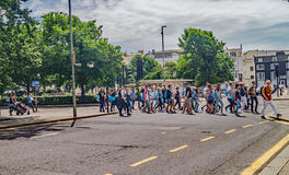 Tourist group crossing at a busy Brighton Road royalty free stock image