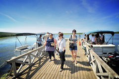 Tourist Group in the Danube Delta. A large group of tourists enjoying the beauty of the Danube Delta Royalty Free Stock Photography