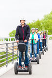 Tourist group driving Segway at sightseeing tour Royalty Free Stock Images