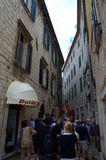 Tourist group on narrow old street. Tourist group on narrow street in Old Town of Kotor.In recent years, Kotor has seen a steady increase in tourists, many of Royalty Free Stock Photography