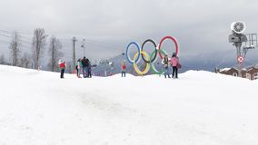 Tourist group near the Olympic rings in Sochi. Sochi - March 29, 2017: A group of people near the bright Olympic rings in the Olympic skiing cluster March 29 Royalty Free Stock Photo