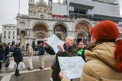Tourist group on San Marco square Stock Photo