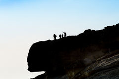 Tourist group on the top of the cliff, photographing and enjoyin. G in the view. Exploring the countryside stock image