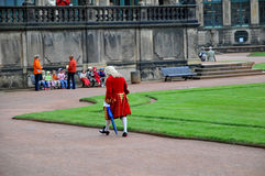 Tourist guide in Baroque costume Royalty Free Stock Images