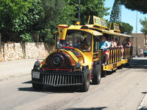 Tourist guide. Tourist train in the streets of the island of Mallorca Stock Image