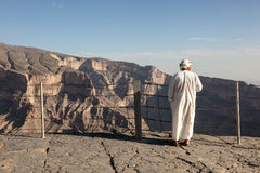 Tourist Guide at the Wadi Ghul, Oman Royalty Free Stock Photos