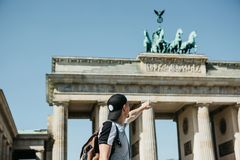 Tourist or guy shows his hand on the Brandenburg Gate in Berlin. In Germany stock photography