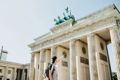 Tourist or guy shows his hand on the Brandenburg Gate in Berlin. In Germany royalty free stock photography