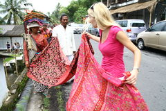 White woman haggling over the scarf Royalty Free Stock Images