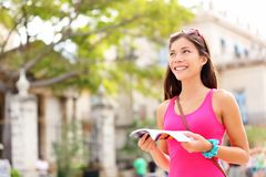 Tourist happy reading guide book Stock Images