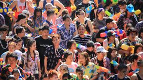 Attendees Water Fight  Or Songkran  Festival. Tourist happy with splash water on songkran day or thai new year  celebrated  local traditional festival in Stock Photography