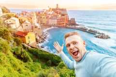 Tourist happy young man taking selfie photo Vernazza, national park Cinque Terre, Liguria, Italy, Europe. Concept travel stock images