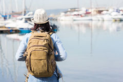 Tourist by harbor Stock Images