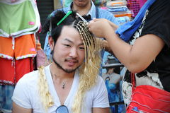 Tourist Has Hair Braided Stock Photo