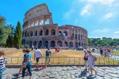 Tourist having fun around Colosseum in Rome