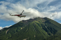 Free Tourist Helicopter Against The Backdrop Of Volcano Priemysh. South Kamchatka Nature Park. Royalty Free Stock Photos - 78175588