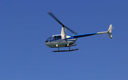 Tourist helicopter. On a clear sky stock images