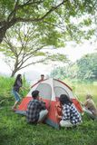 Tourist help each other prepare tent. Couple tourist help each other prepare tent at natural lake in background Stock Images
