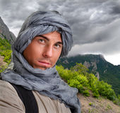 Tourist hiding his head under a shawl Stock Photo